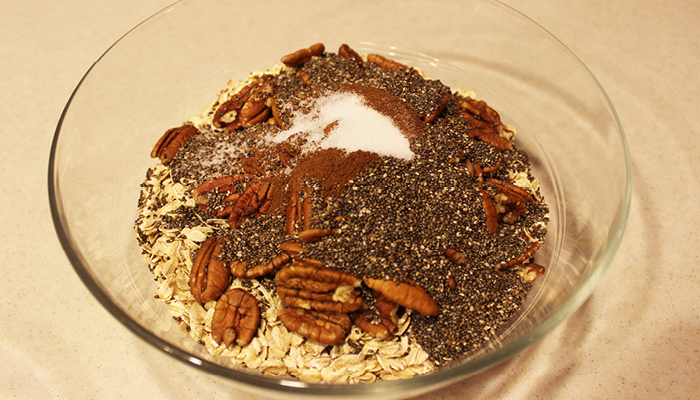 Dry granola ingredients in glass bowl