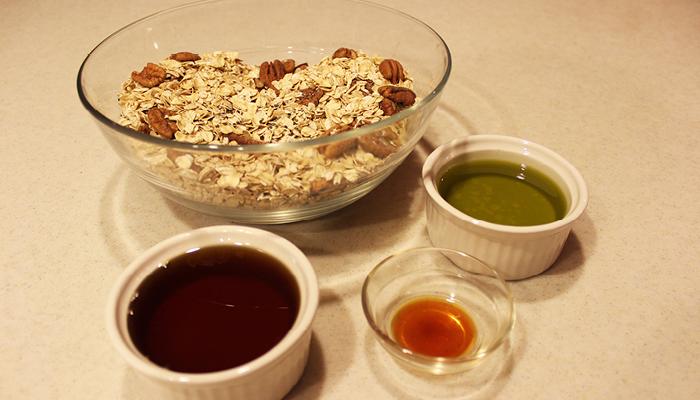 Wet granola ingredients in separate bowls
