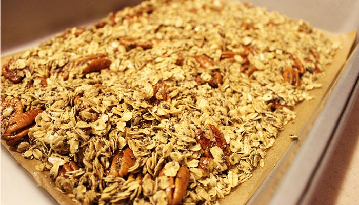 Mixed granola spread on baking sheet