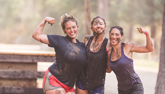 Three active girls covered in mud