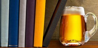 mug of beer and stack of books