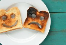 two pieces of toast on plate, one is burnt