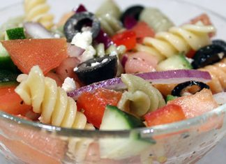 prepared greek pasta salad in glass bowl