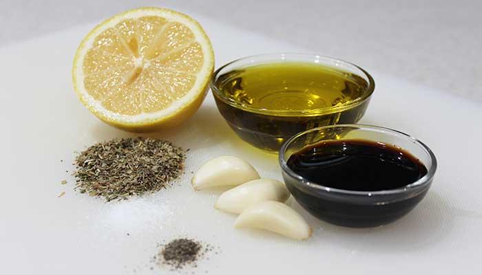 half lemon, garlic cloves, balsamic vinegar, olive oil, and seasoning