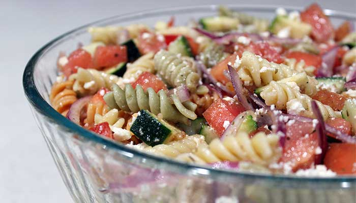 closeup of prepared greek pasta salad