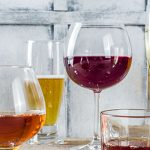 glassware full of beer, wine, and liquor   when does drinking become a problem