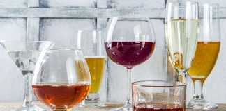 glassware full of beer, wine, and liquor | when does drinking become a problem