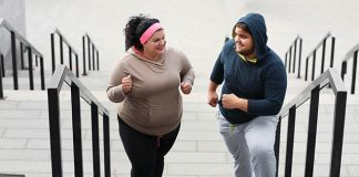 overweight friends exercising on stairs | what workout is recommended for plus size
