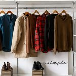 simple modern wardrobe with hanging garments   the benefits of eco-friendly fashion