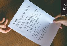 Student Advocate: resume being passed between two people