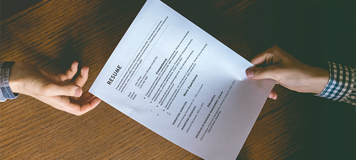 resume being passed between two people
