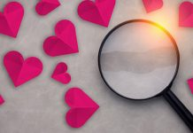 paper hearts and magnifying glass
