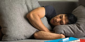 male napping on couch | fragmented sleep