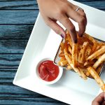 hands grabbing french fries   healthy study snacks