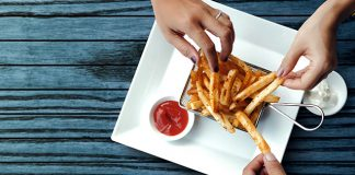 hands grabbing french fries | healthy study snacks