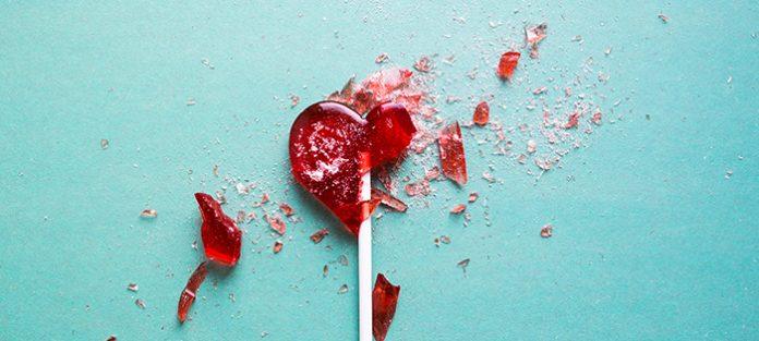 broken red heart lollipop | traumatic event