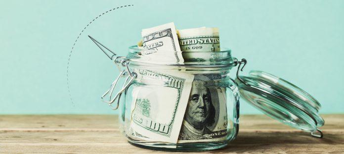 Jar of cash with credit score gauge