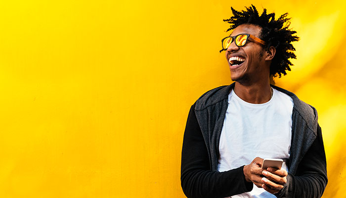 happy guy against yellow wall