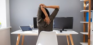 female stretching at desk