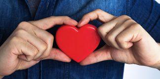 man holding heart | men's health month