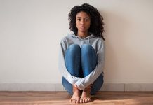 young woman sitting on floor | sexual assault resources