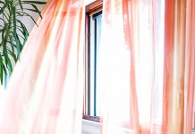 orange curtains in breezy window | tips to stop worrying