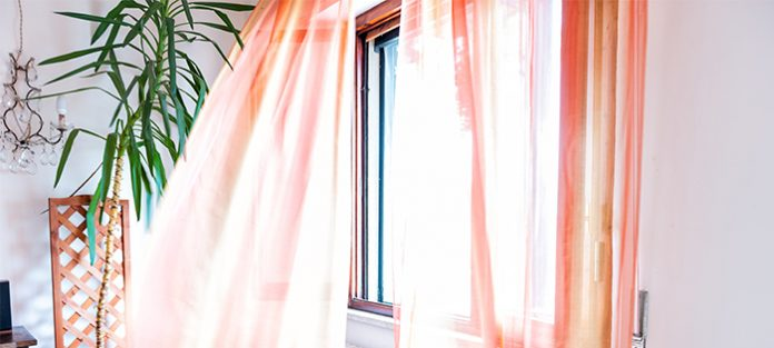 orange curtains in breezy window   tips to stop worrying