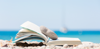 book on windy beach with bright blue water | how to make time for reading