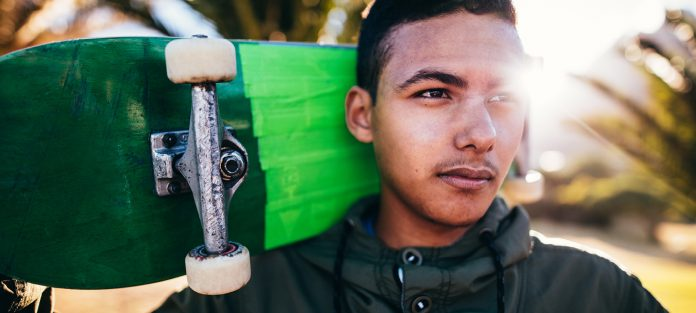 ambitious male with skateboard