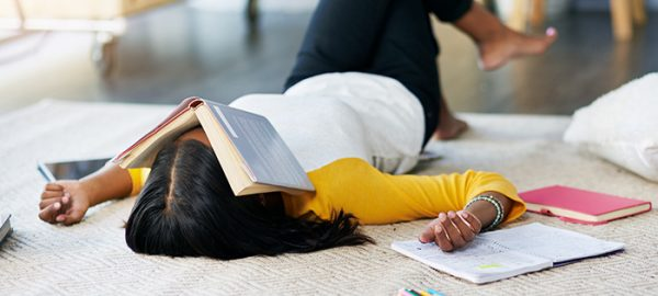 female trying to stay awake while studying