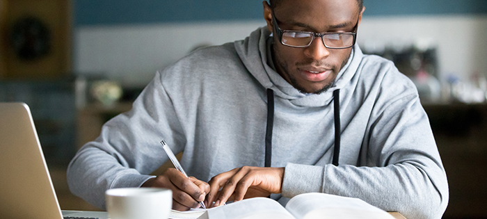 male student practicing his best study method