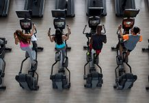is cardio necessary | Line of people on ellipticals