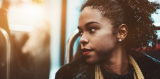 pensive woman gazing out of bus window, suicide prevention concept