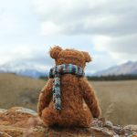 teddy bear looking at mountains | self compassion meditation