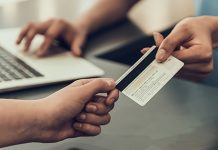 customer paying with card | money management tips for college students
