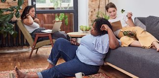 female roommates lounging in common area | are you a good roommate quiz