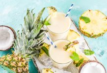 pineapple, coconut, and pina coladas on blue background | healthy pina colada smoothie