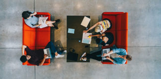 Above shot of group of students working together at couches and table