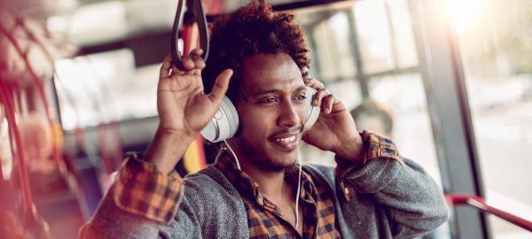 commuter enjoying bus ride with headphones