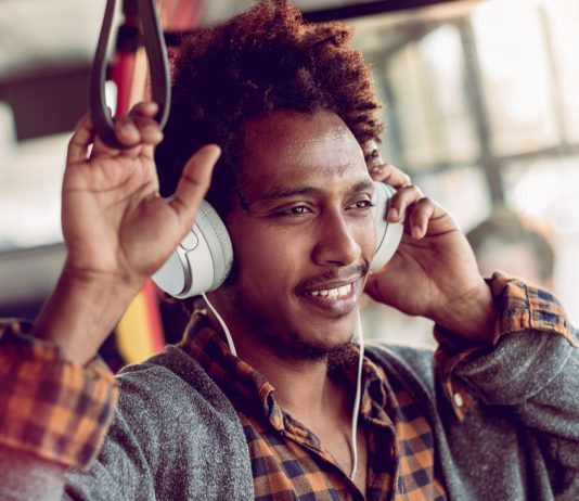 Student advocate: commuter enjoying bus ride with headphones