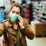 girl grocery shopping with mask on