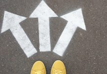 Woman standing near arrows against asphalt | advice for changing careers