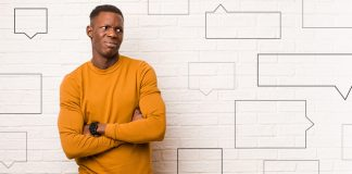 confused and disappointed Black male surrounded by speech bubbles | how to respond to racial microaggressions