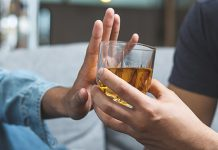 man refusing alcoholic drink | benefits of being sober