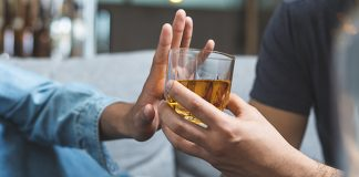 man refusing alcoholic drink   benefits of being sober