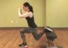 Fitness trainer performing leg exercise with bench