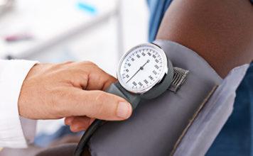 Patient receiving blood pressure check
