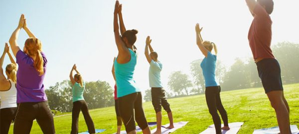 group yoga in park