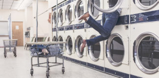 Person getting stuck in machine at laundromat