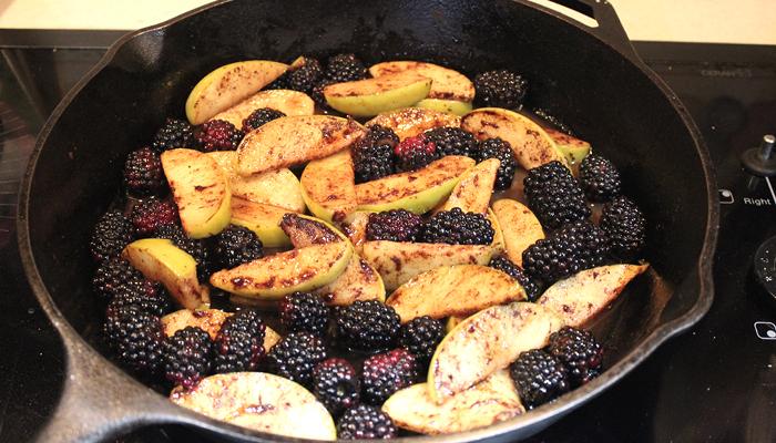 apple slices and blackberries in skillet